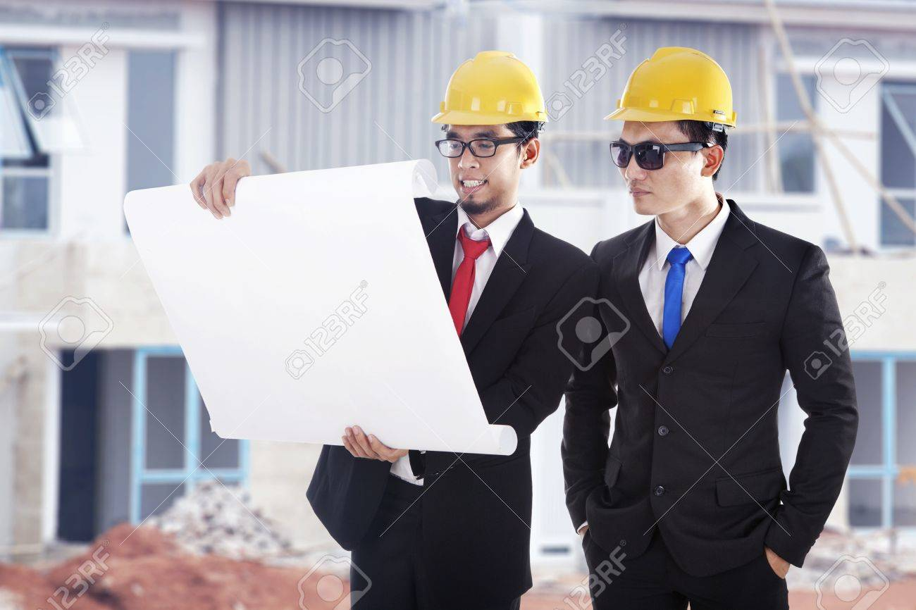 Architect and construction engineer or surveyor discussion plans and blueprints shot at construction site Stock Photo - 14684357