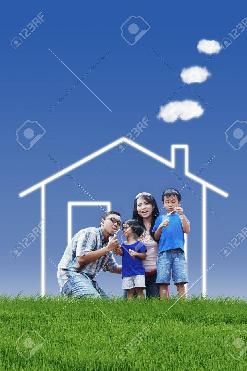 Portrait of asian family with dream house playing bubble outdoor Stock Photo - 14683638