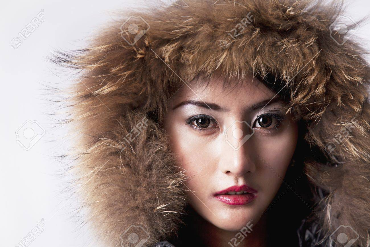 High fashion female model beauty shoot with fur jacket. shot in studio Stock Photo - 14690553