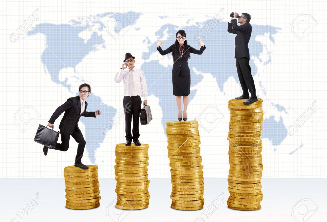 Business success concept: Businessmen and businesswoman standing on stacks of golden coins Stock Photo - 14684035