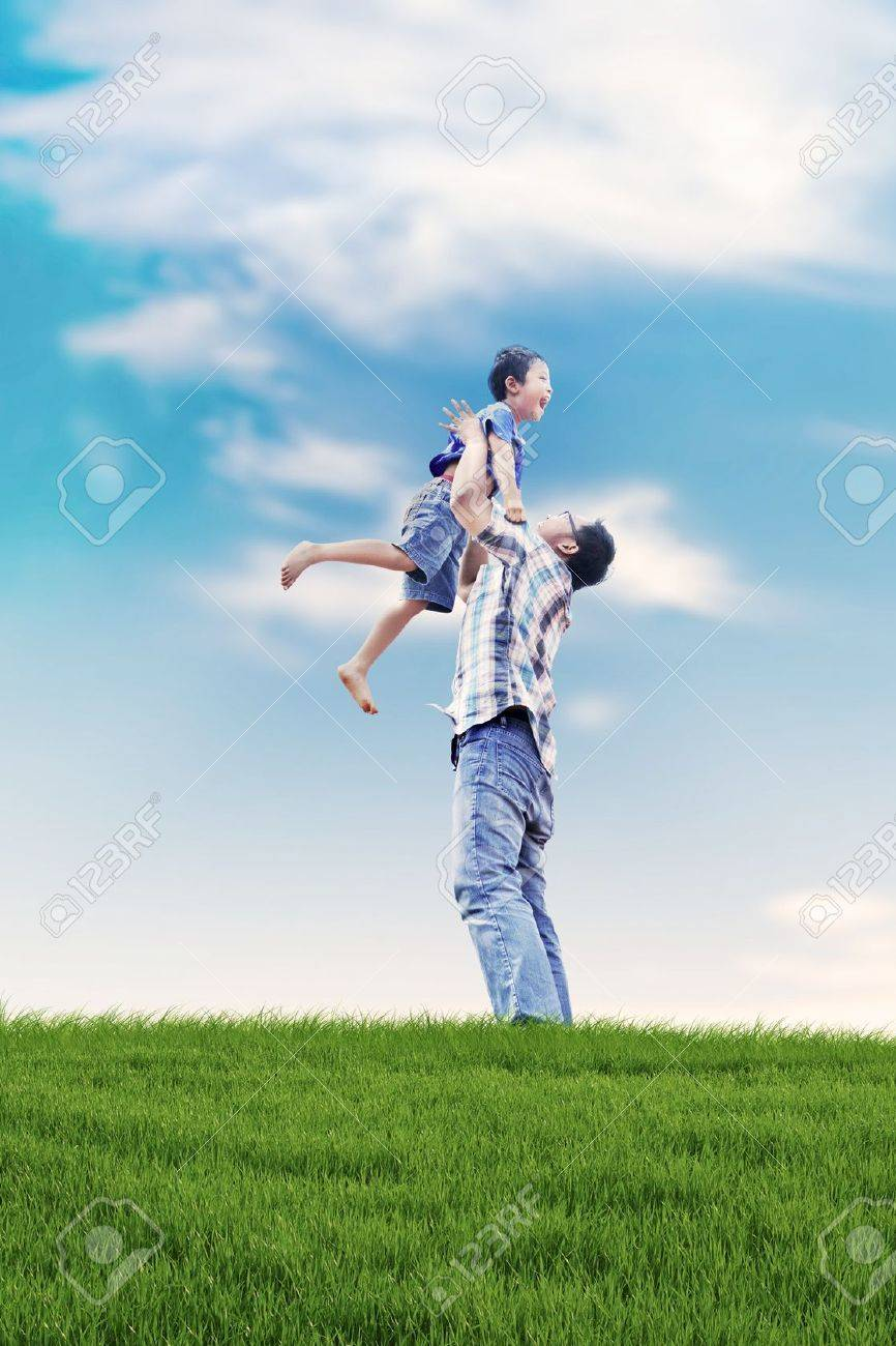 Asian family spending a fun summer day in meadow Stock Photo - 14684425