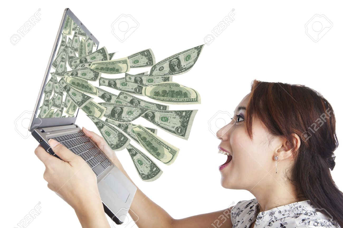 Young woman with laptop and money in great on-line business Stock Photo - 14684424
