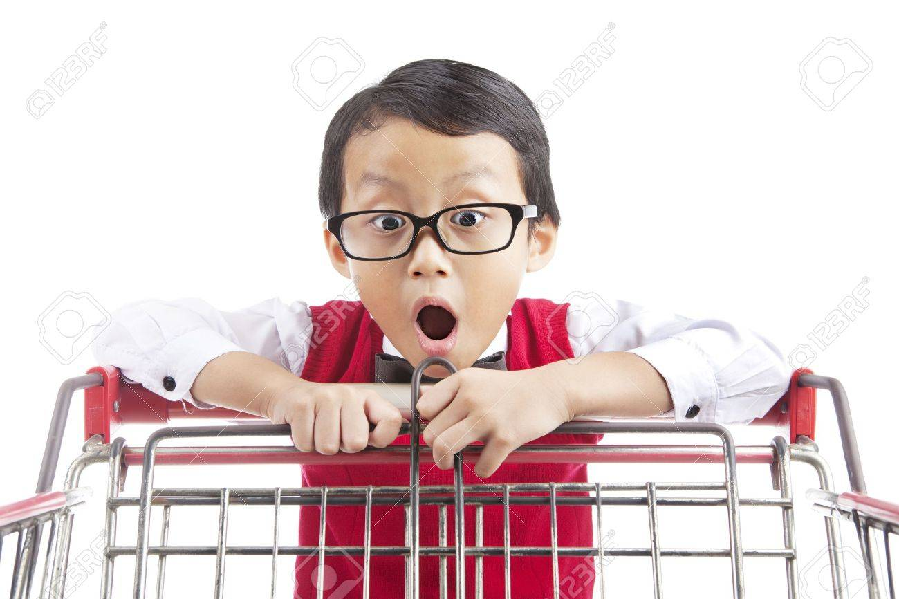 Face expression of shocked male elementary school student looking at shopping cart Stock Photo - 14779033