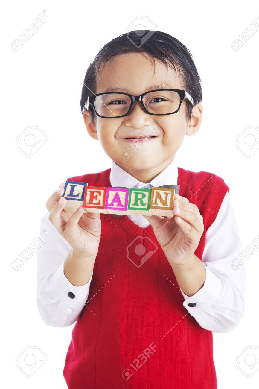 Portrait of asian elementary school student showing letter blocks spelling out LEARN. shot in studio isolated on white Stock Photo - 14779110