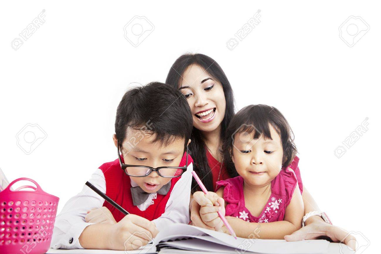 Portrait of young asian mother guiding her children to draw on the paper Stock Photo - 15193325