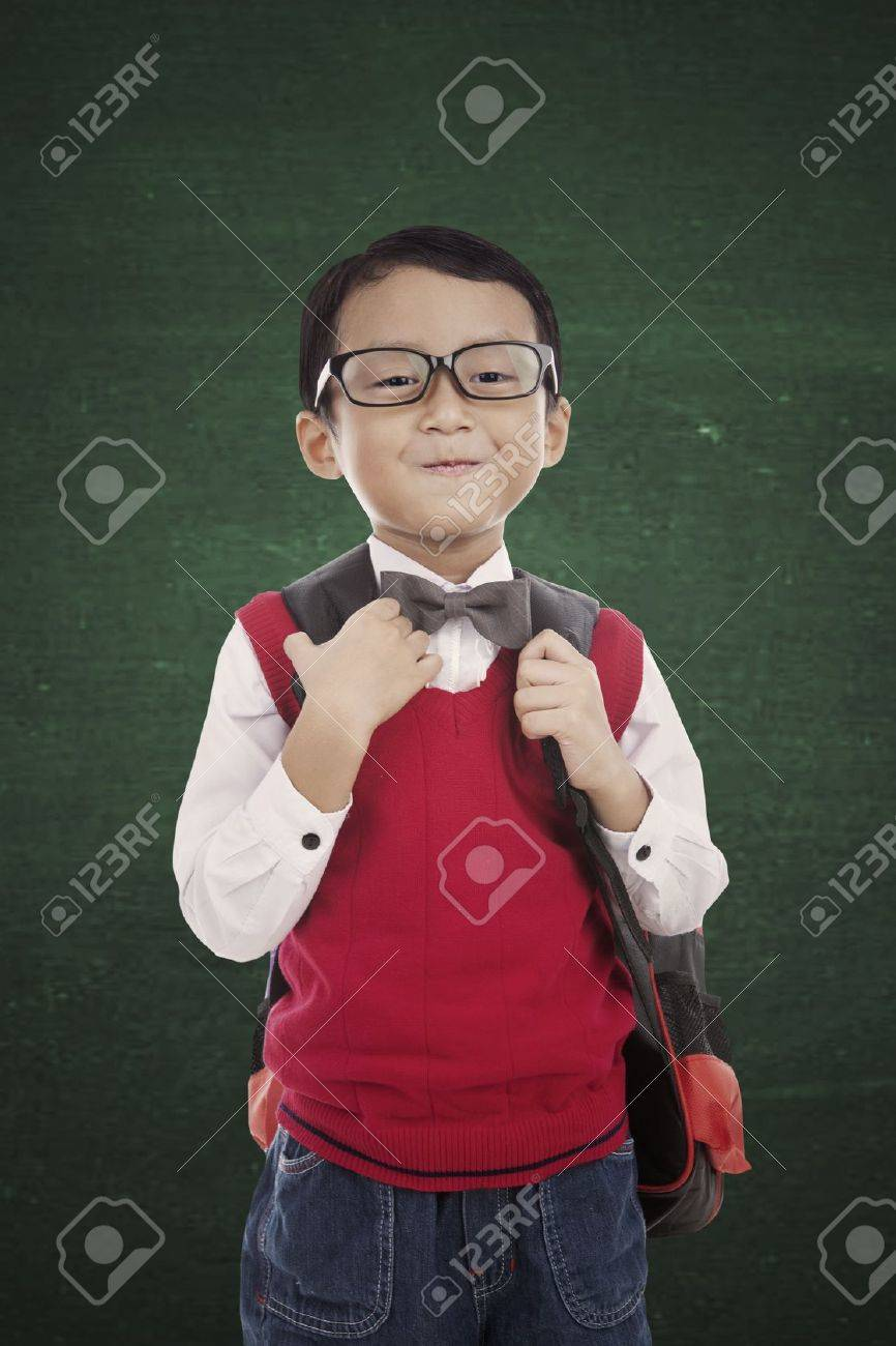 Portrait of 5 years old boy standing in fornt of blackboard and ready to school Stock Photo - 15263980