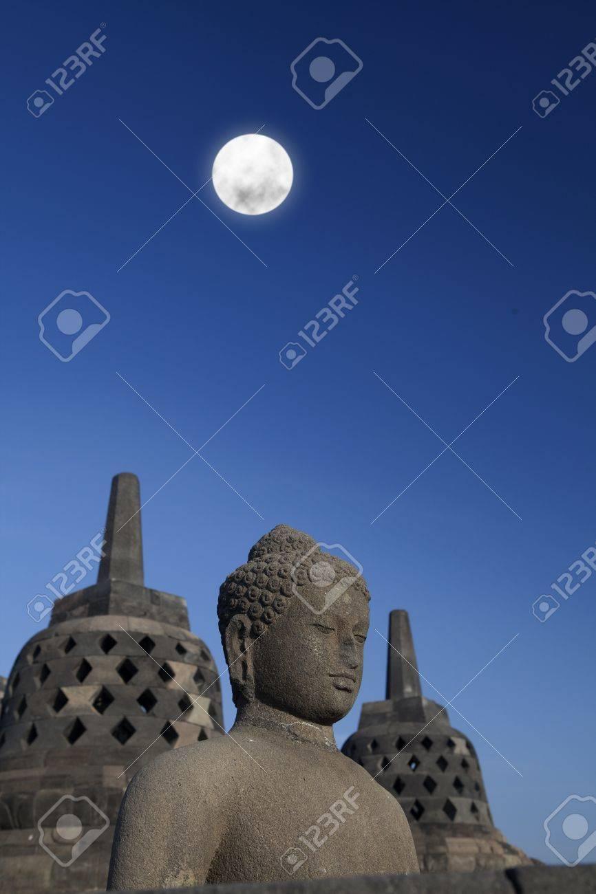 Shot of statue and stupa at borobudur temple, Yogyakarta, Java, Indonesia. Stock Photo - 15301709