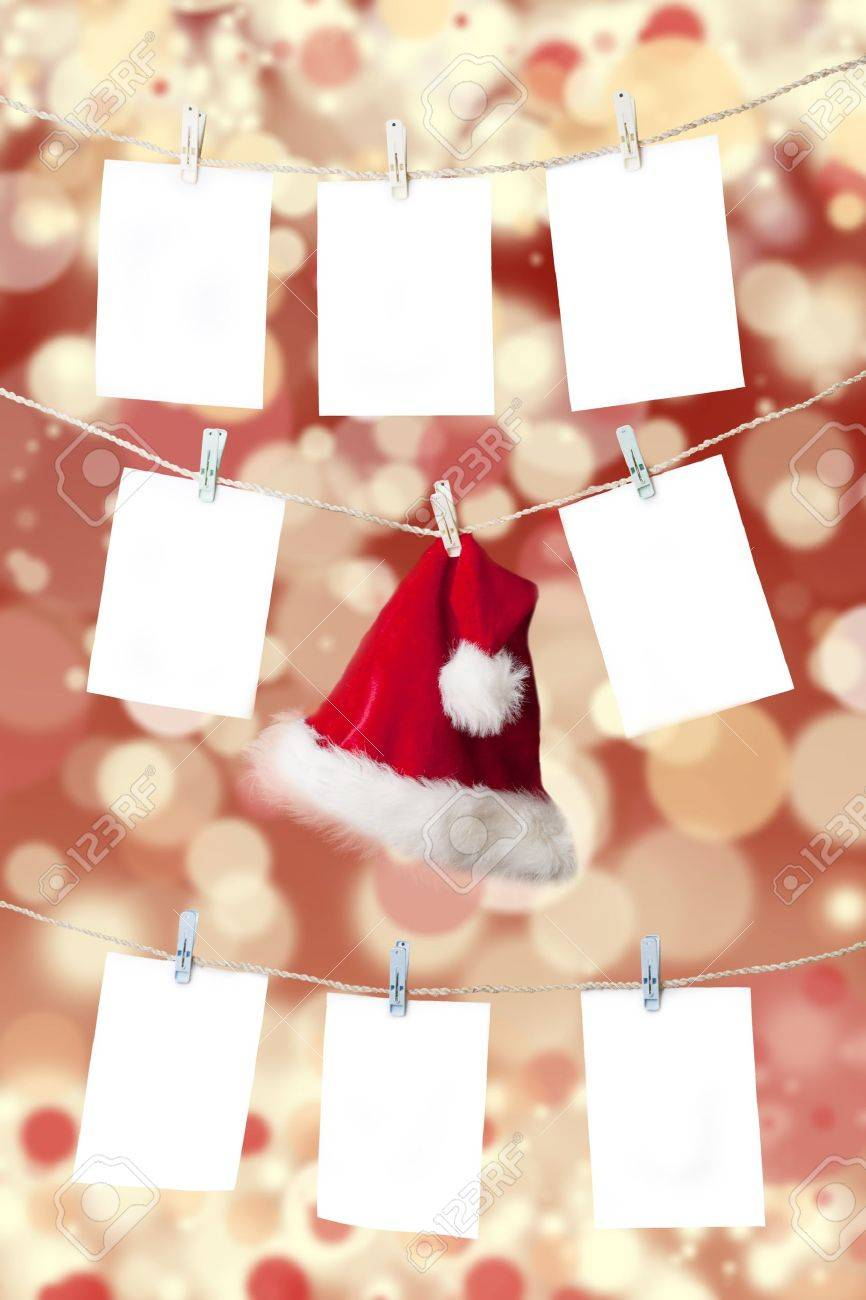 Christmas pricing tags and santa's hat hanging on the rope with christmas defocused light background Stock Photo - 15474429