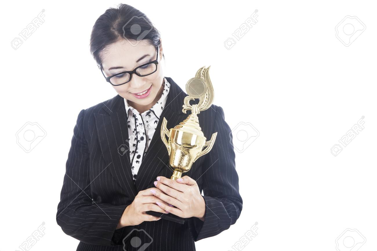 A proud businesswoman holding a trophy in her hands Stock Photo - 15637882
