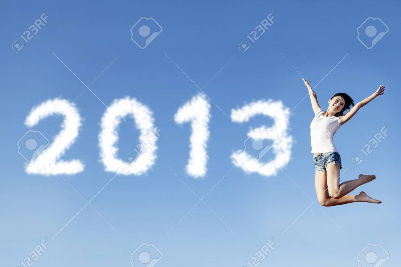 A female jumping to welcome the new year of 2013 Stock Photo - 16011260