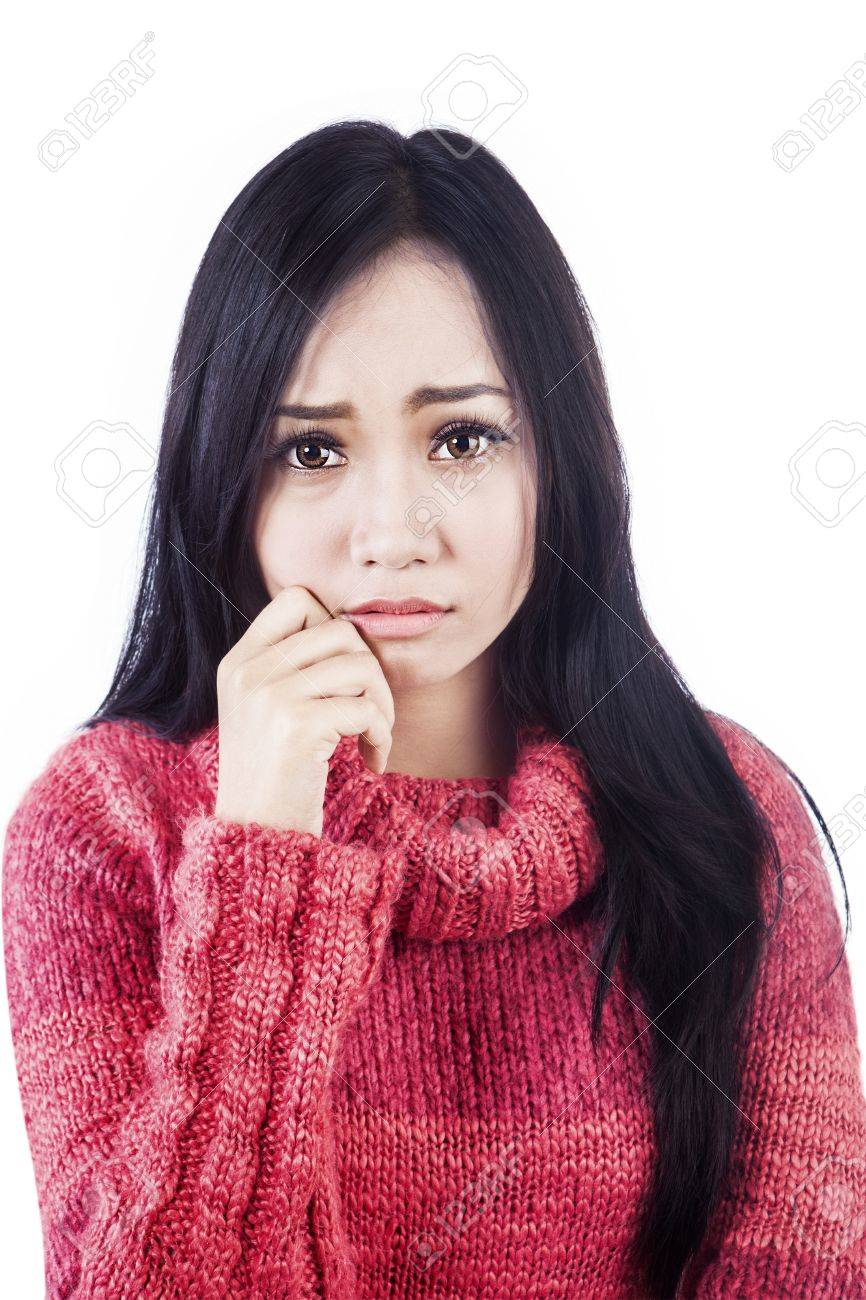 Portrait of sad woman wearing red sweater. isolated on white bakground Stock Photo - 16085500