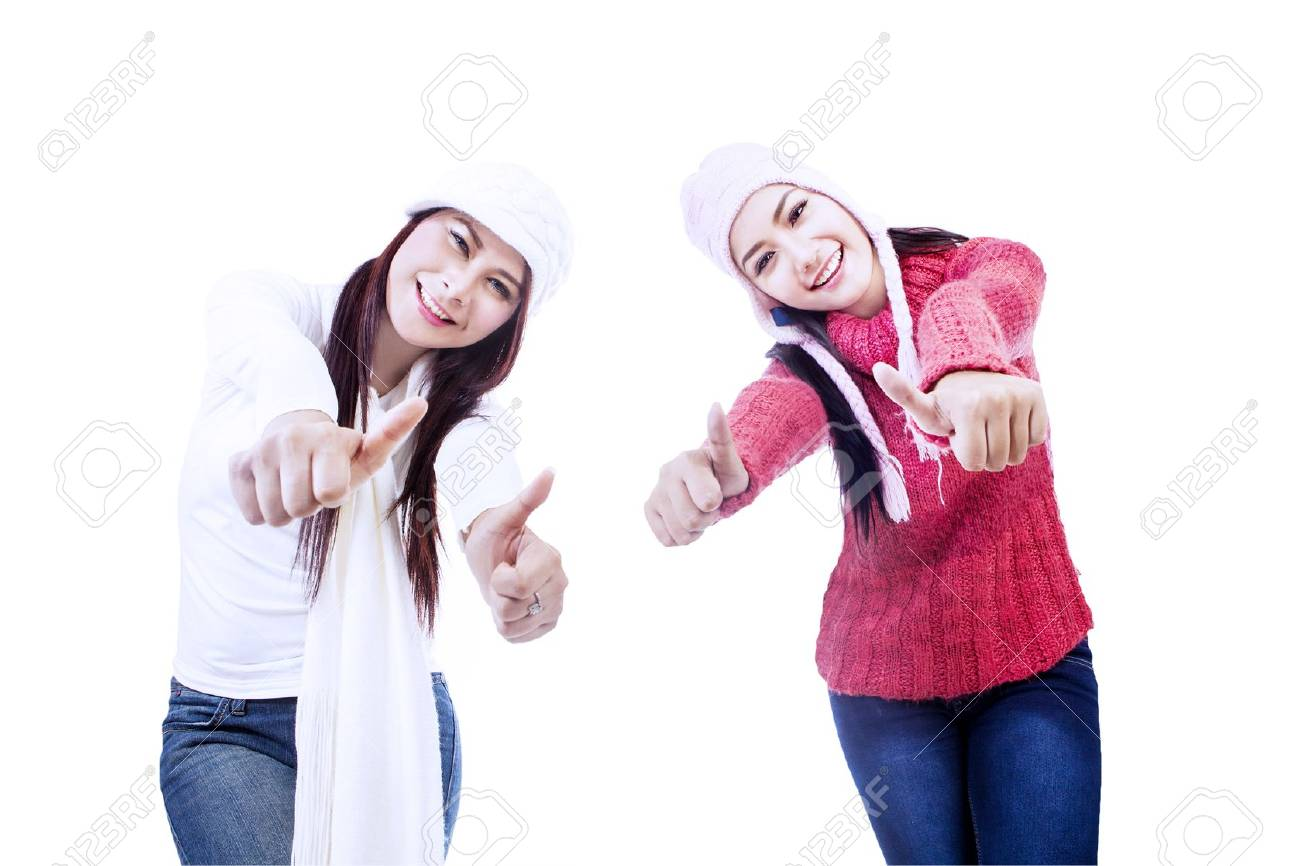 Two sisters are excited upon successful project, isolated in white Stock Photo - 16660524