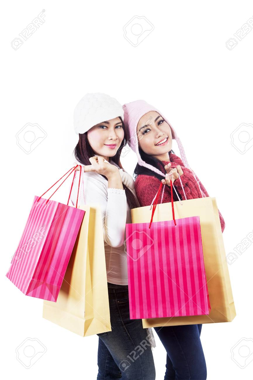 Two friends are shopping together, carrying many bags in white background Stock Photo - 16660526