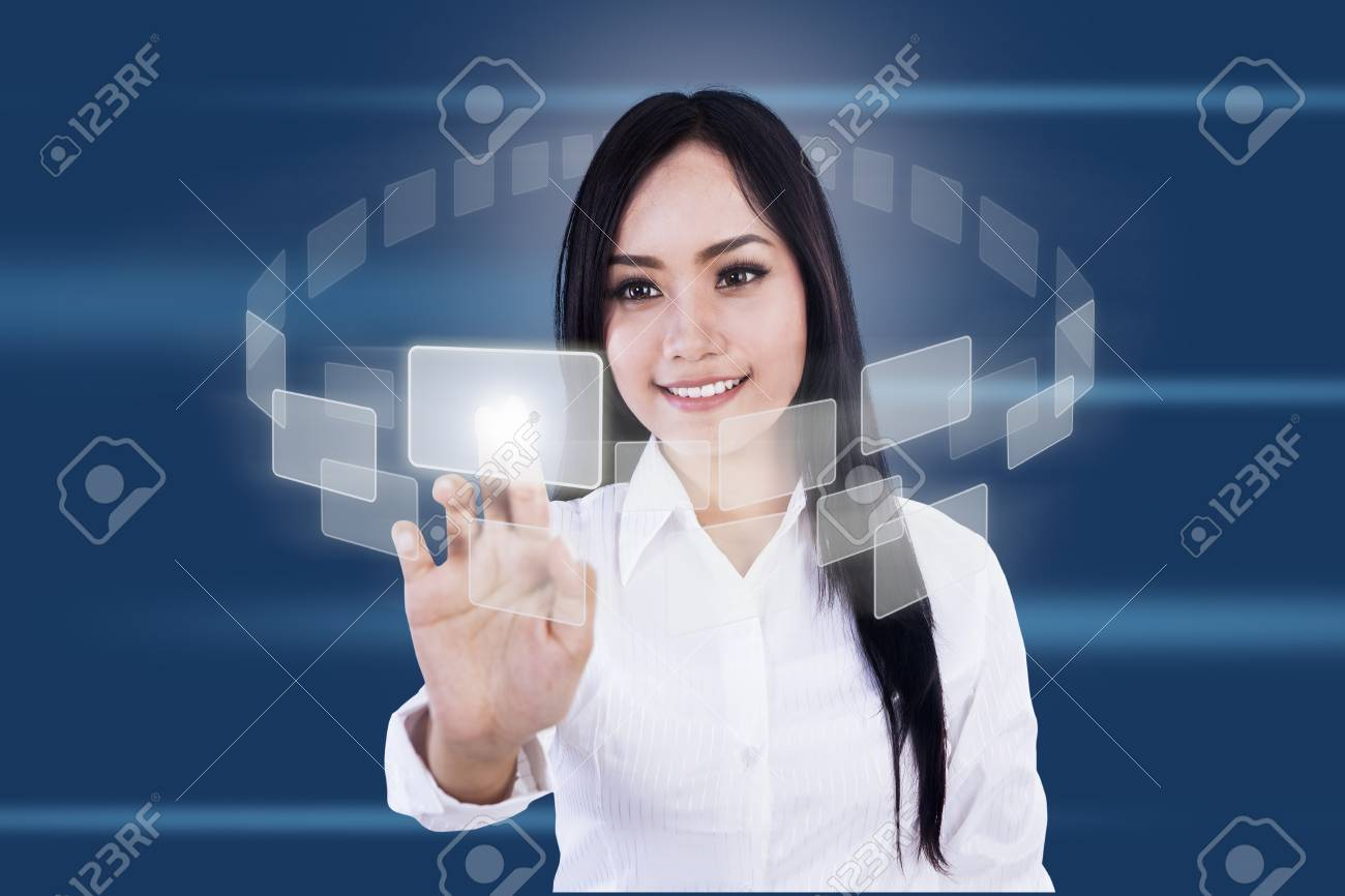 Businesswoman is pressing virtual icons on blue background Stock Photo - 17382373