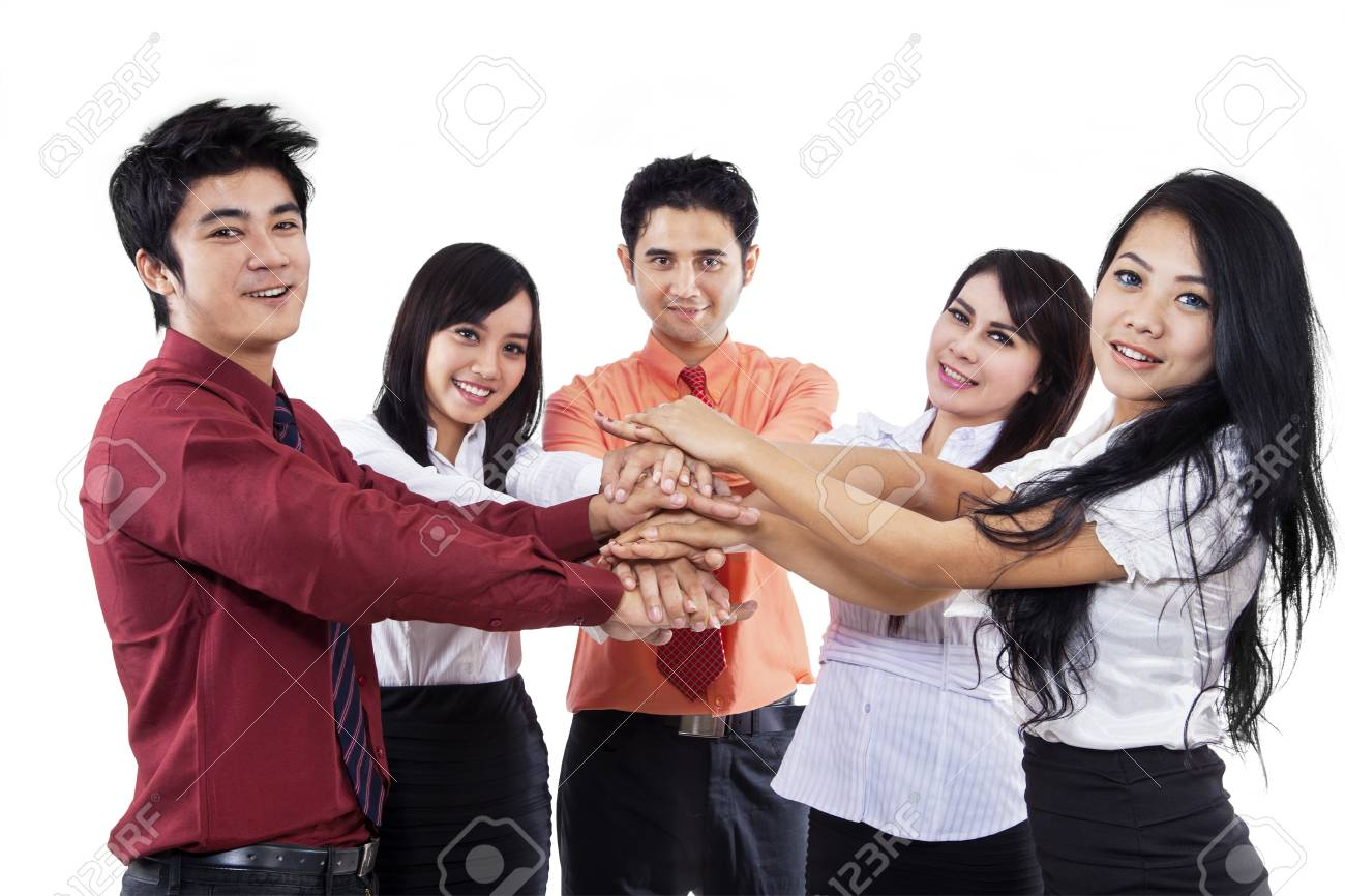 Business team joining hands for unity, isolated on white Stock Photo - 18196215