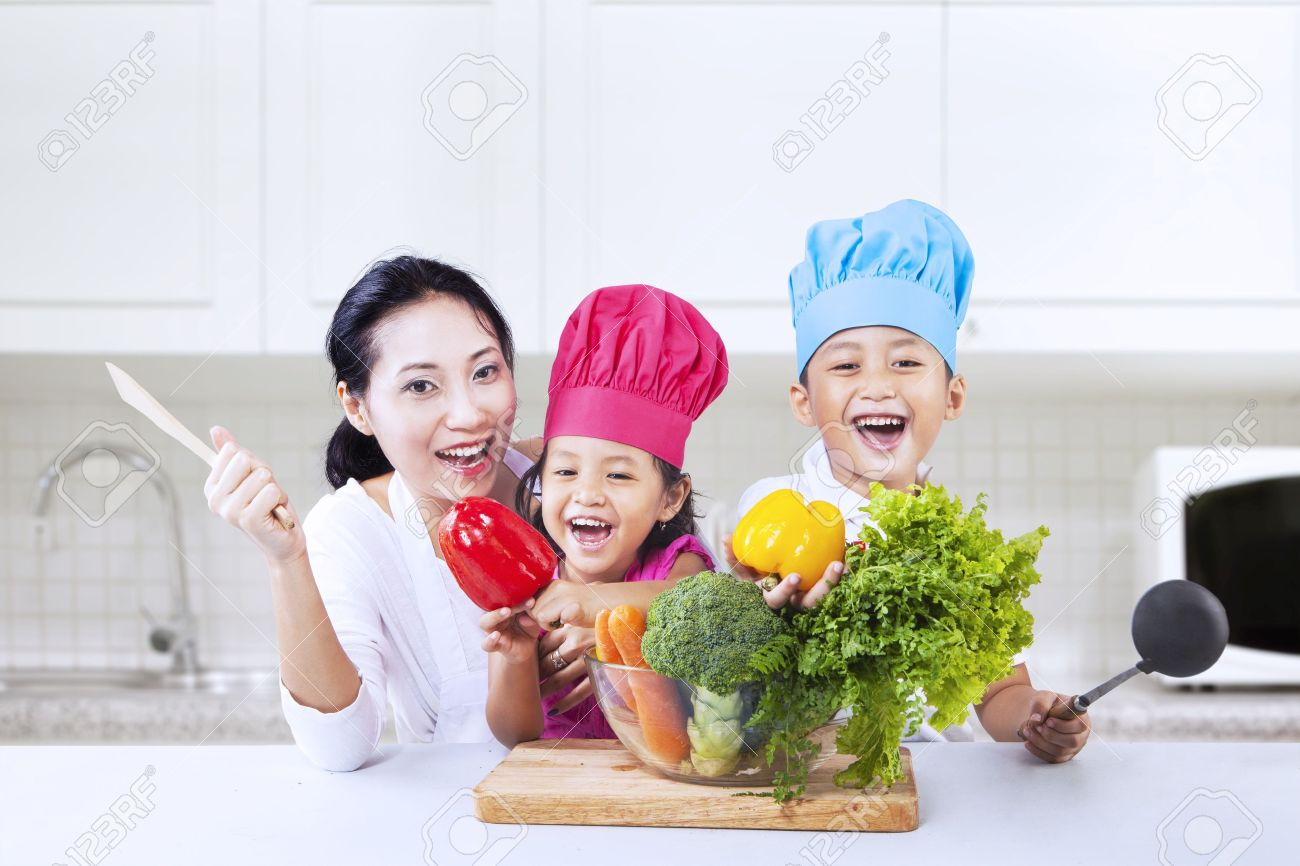 Happy family in kitchen - Happy Family Is Cooking In The Kitchen Together Stock Photo 18498375