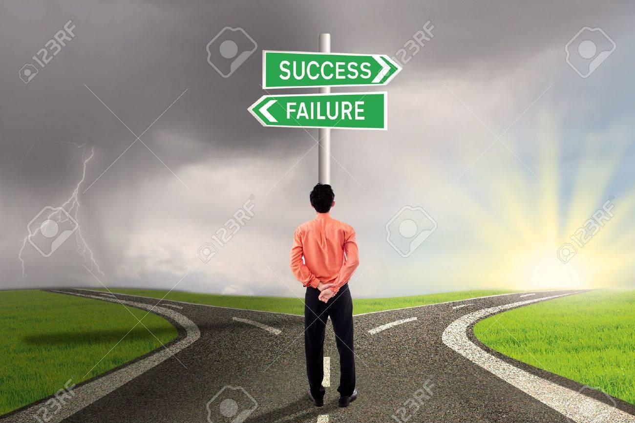 Businessman is choosing success or failure road Stock Photo - 18632477