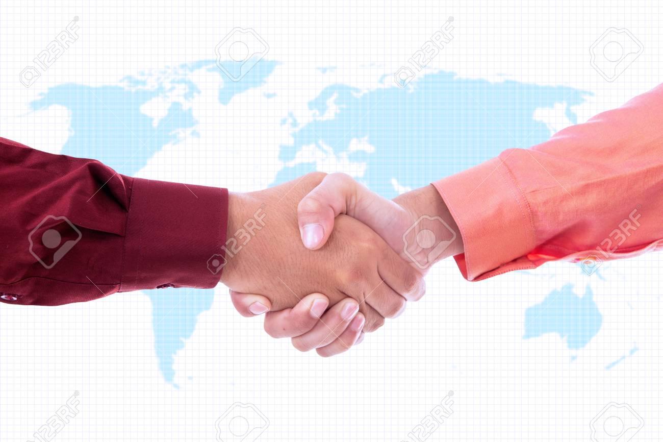 Two businessmen handshaking on world map background Stock Photo - 18676185
