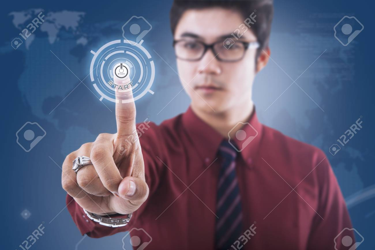 Businessman push on touchscreen button on blue world map background Stock Photo - 18936769
