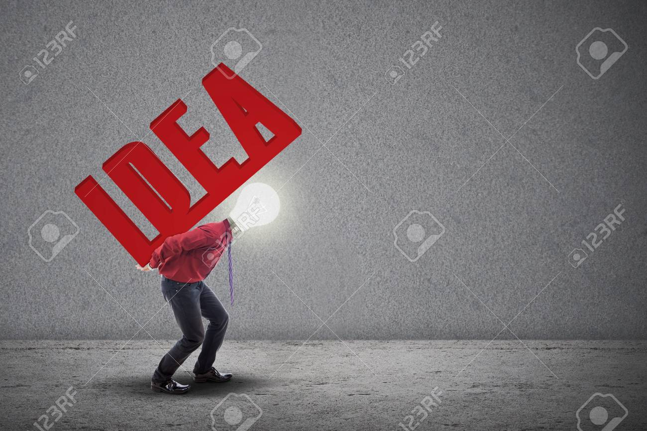 Light bulb head is carrying the word IDEA at his back on grey background Stock Photo - 18936762