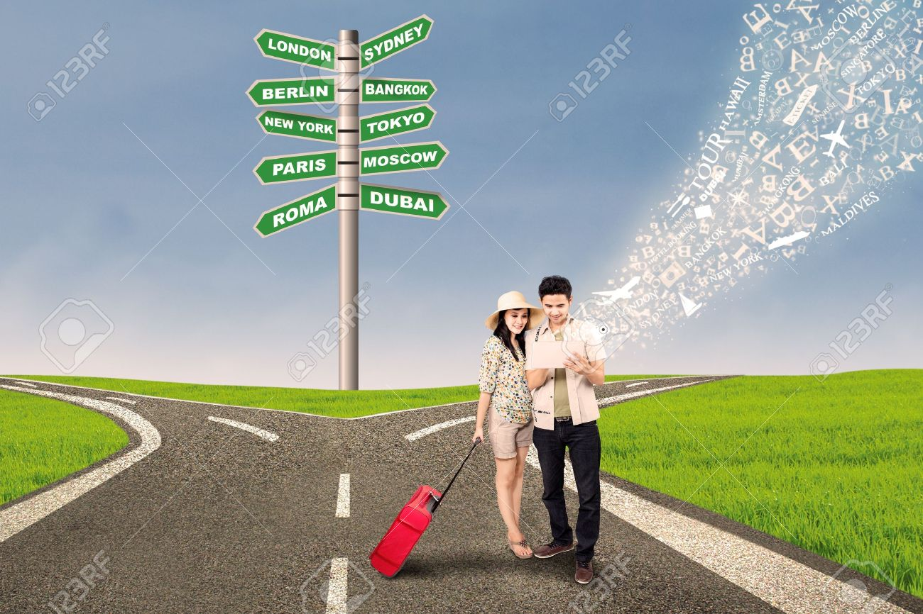 Couple is looking for travel direction online at cross road with e-tablet Stock Photo - 19294099