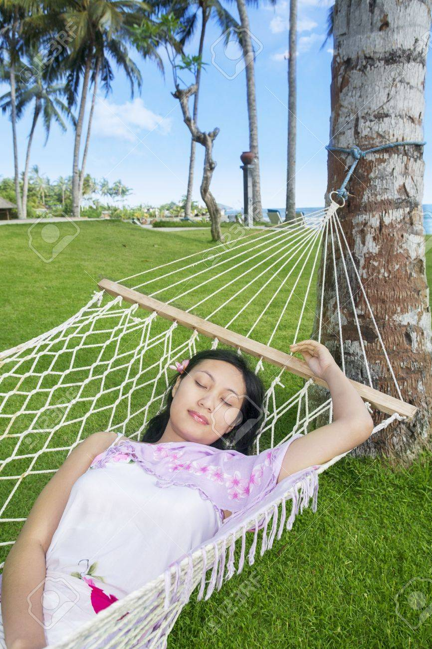 Asian woman sleep in hammock by the beach Stock Photo - 19425706