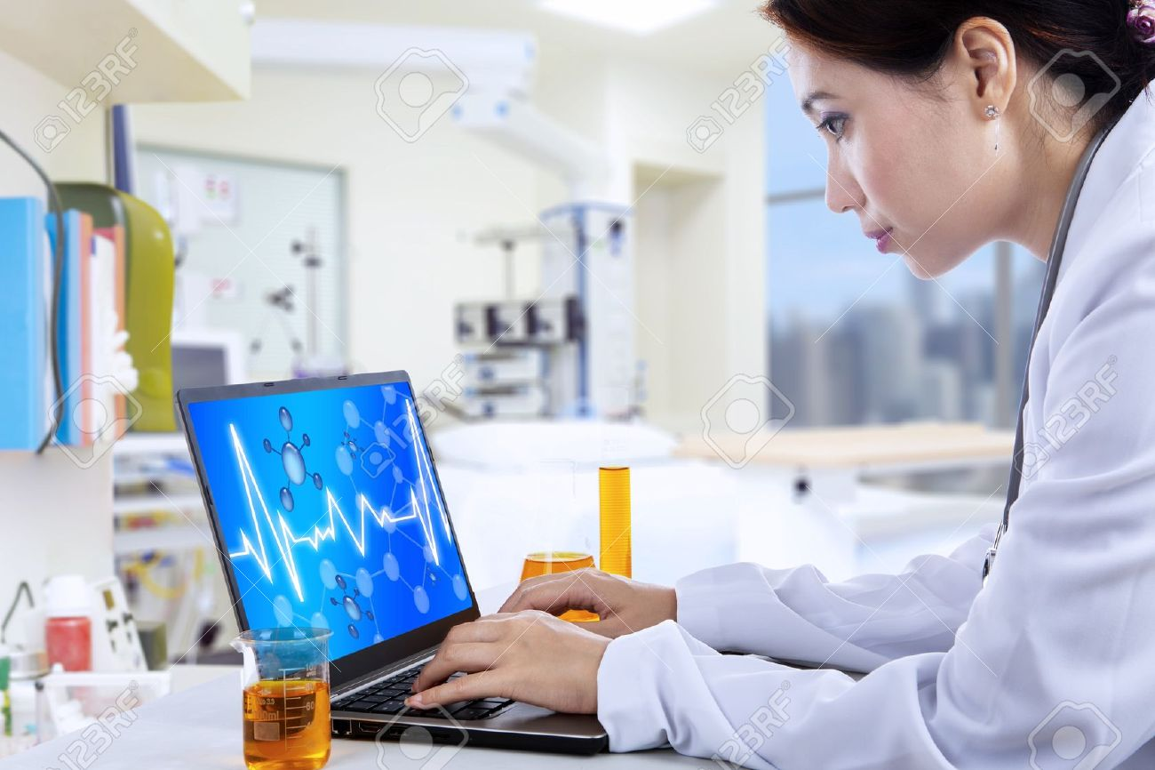 Attractive female doctor working with laptop in lab Stock Photo - 20772817