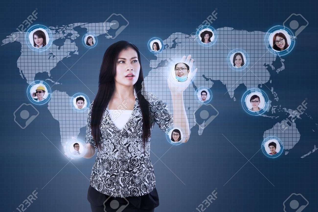 Beautiful businesswoman touch on worker's head online with blue digital background Stock Photo - 21380930
