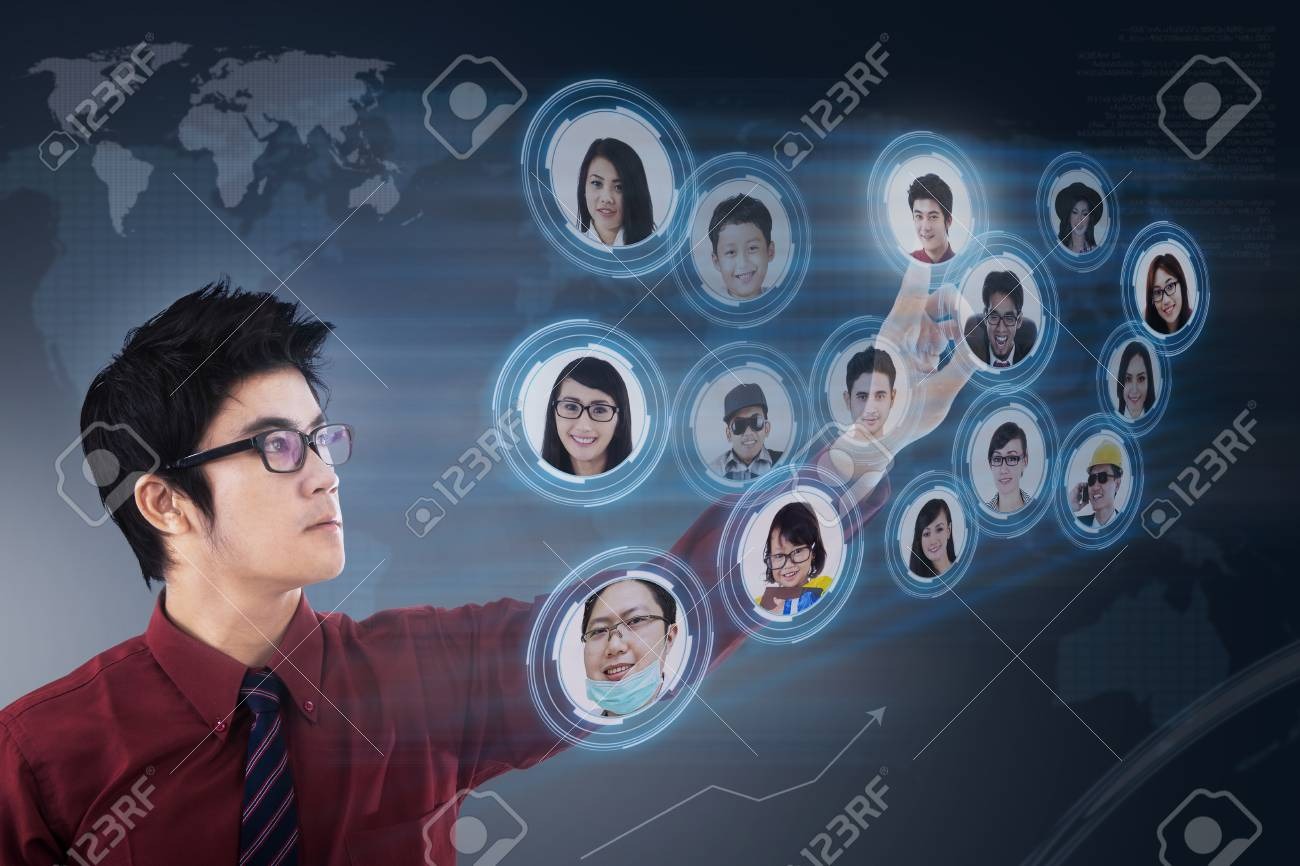 Businessman is choosing few candidates for his business on digital touchscreen Stock Photo - 21380946