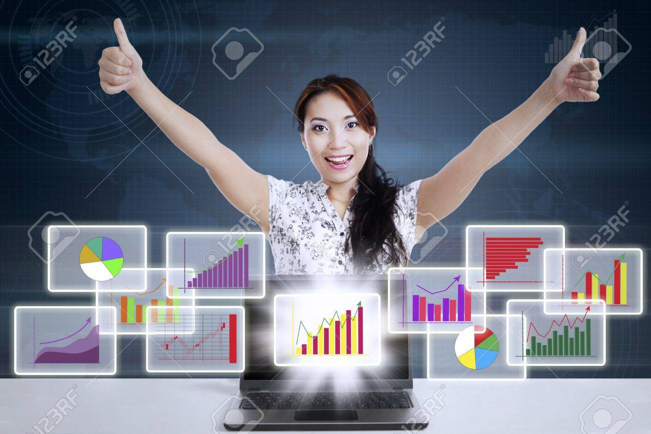 Successful businesswoman giving thumbs-up with different types of diagrams in 3d space Stock Photo - 21380961