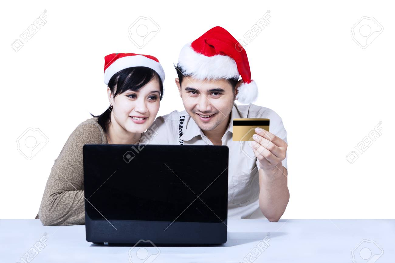 Romantic couple buying christmas gift online, isolated on white Stock Photo - 22961388