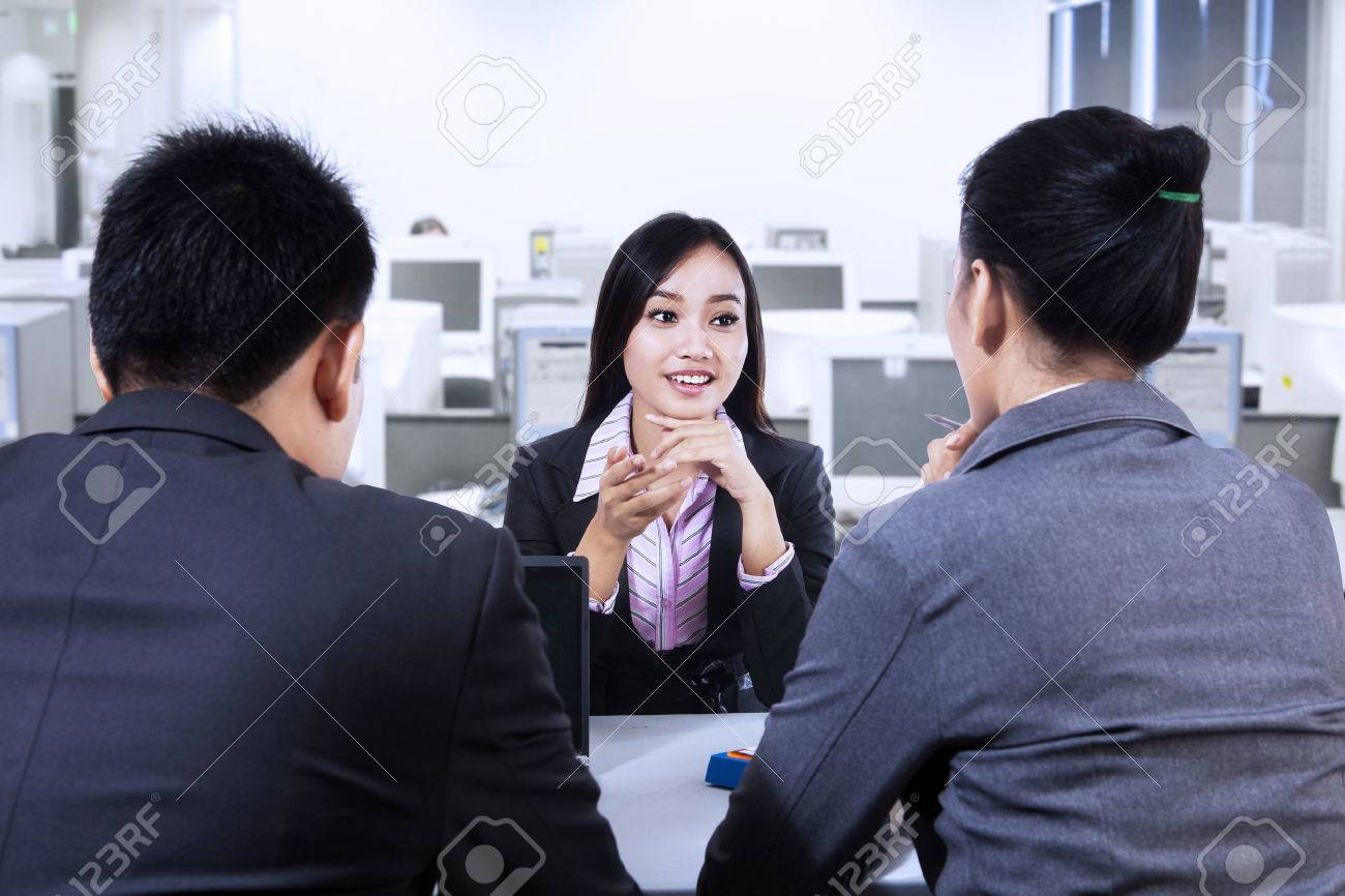 two business people having job interview young w stock stock photo two business people having job interview young w