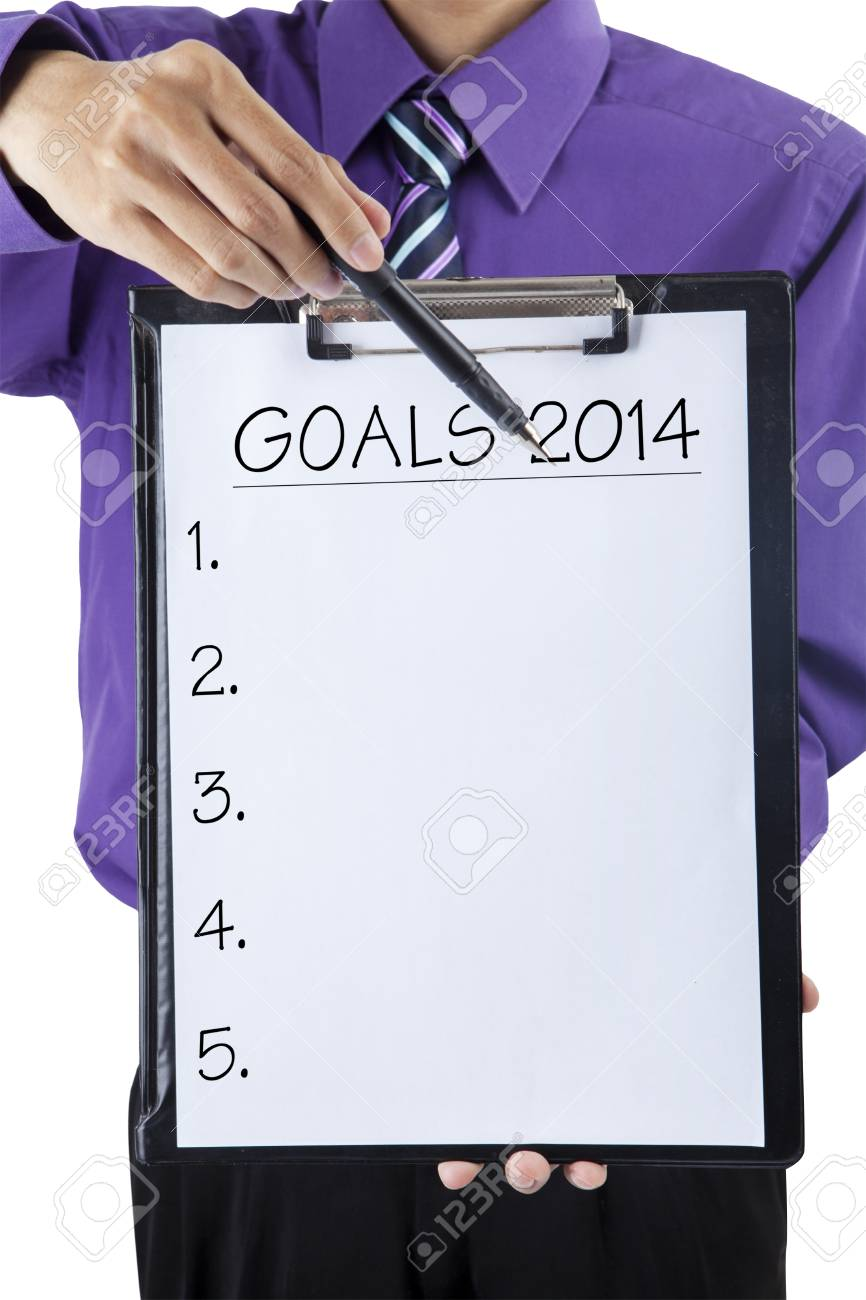 A businessman showing blank 2014 goals list. isolated on white background Stock Photo - 25945192