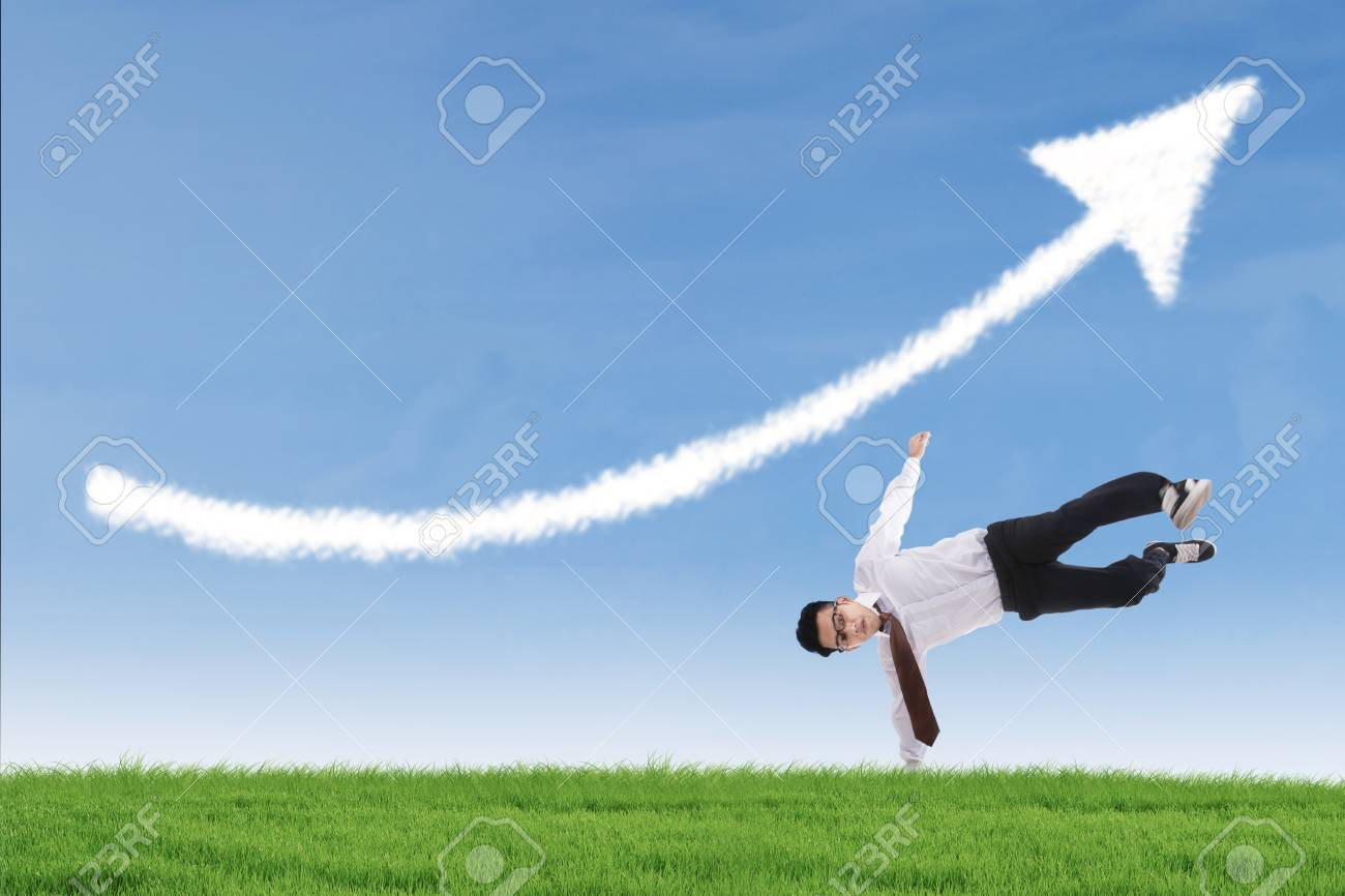 Businessman perform success move under up arrow cloud outdoor Stock Photo - 26544835