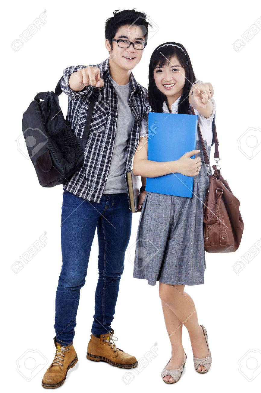 Happy Trendy College Students With Bags And Books Posing Together Pointing At Camera