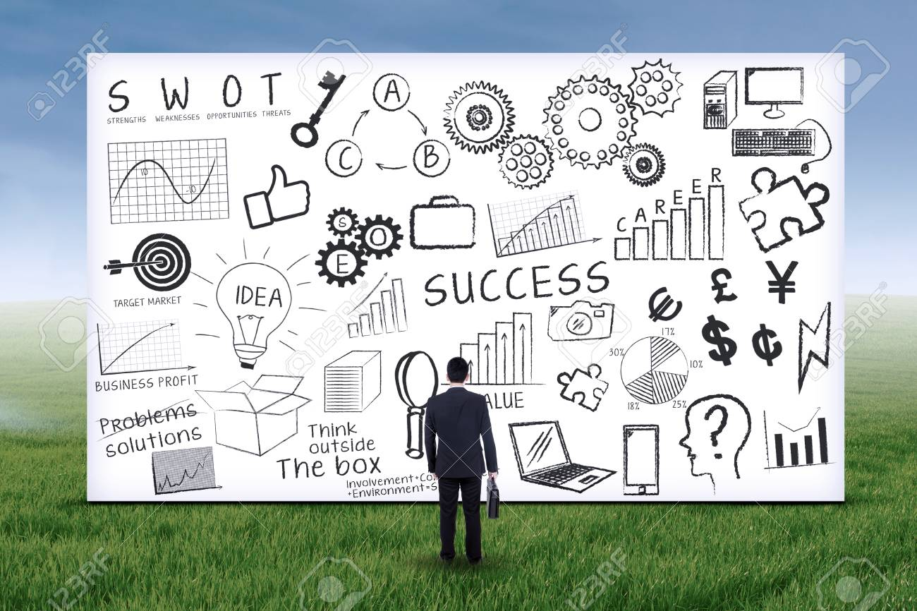Businessman looking at business strategy on whiteboard. Shot outdoors Stock Photo - 28015912