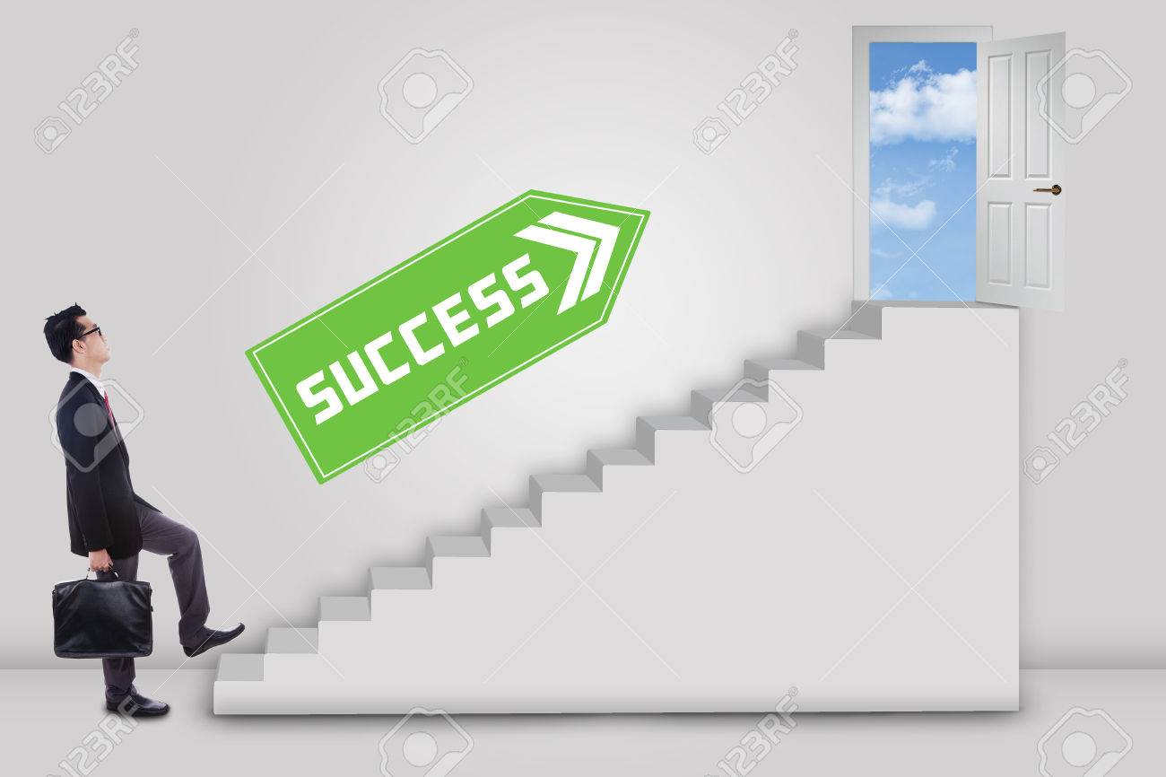 Businessman stepping up to the door of success with an arrow direction to the door Stock
