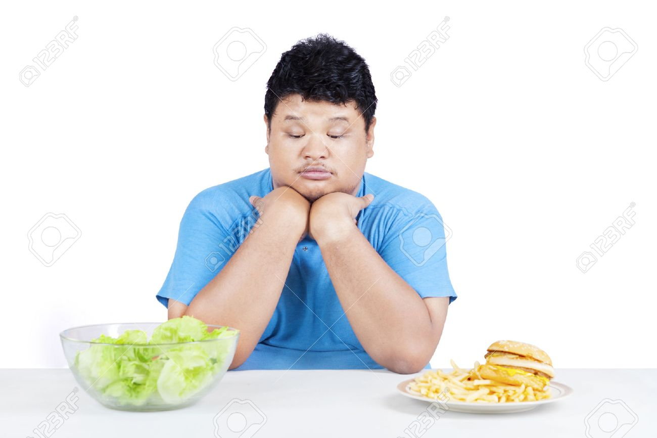 Confused Person To Eat Healthy Food Or Fast Food, Isolated On White Stock  Photo