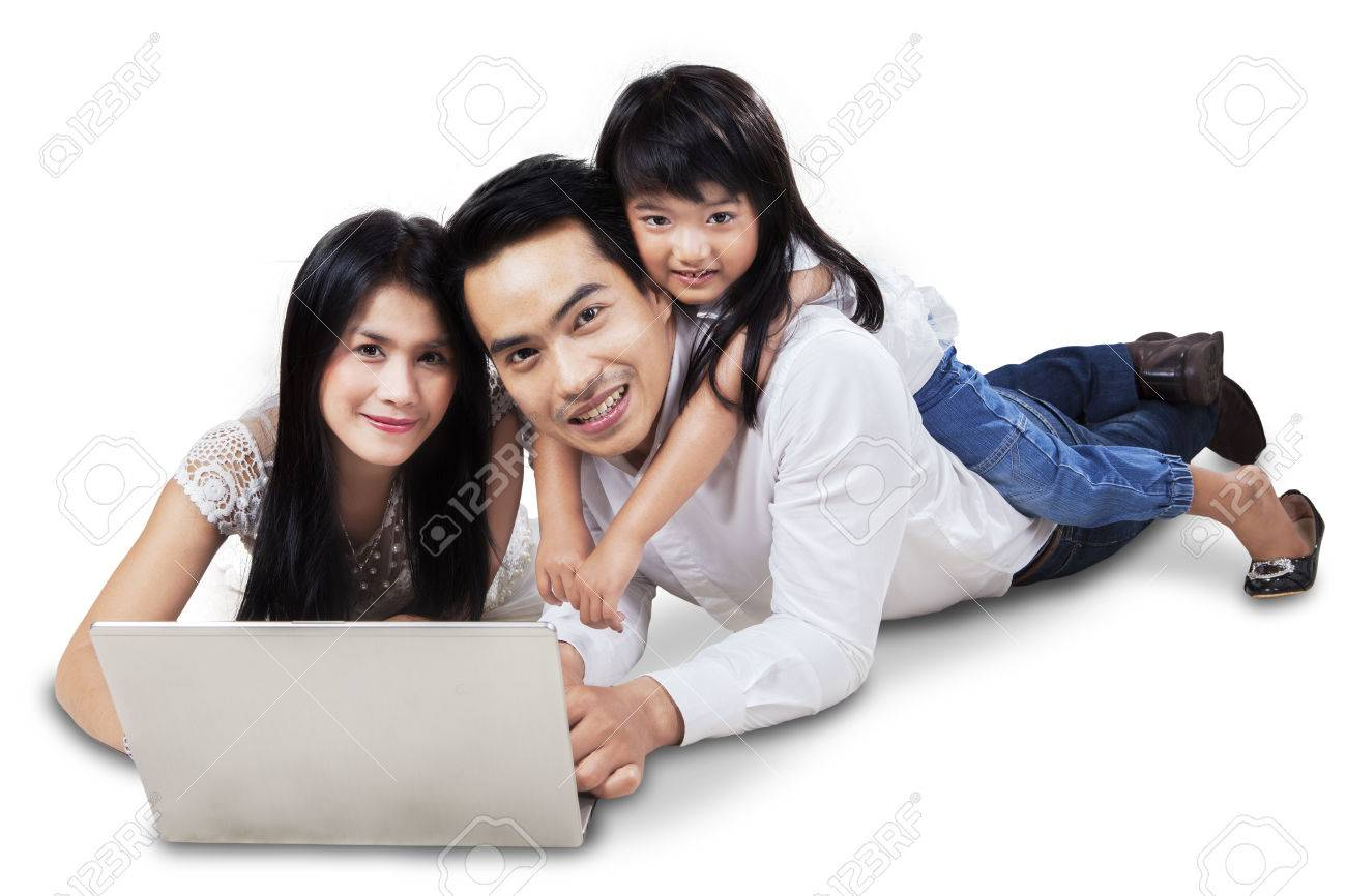 happy family lying down on the floor while surfing on internet