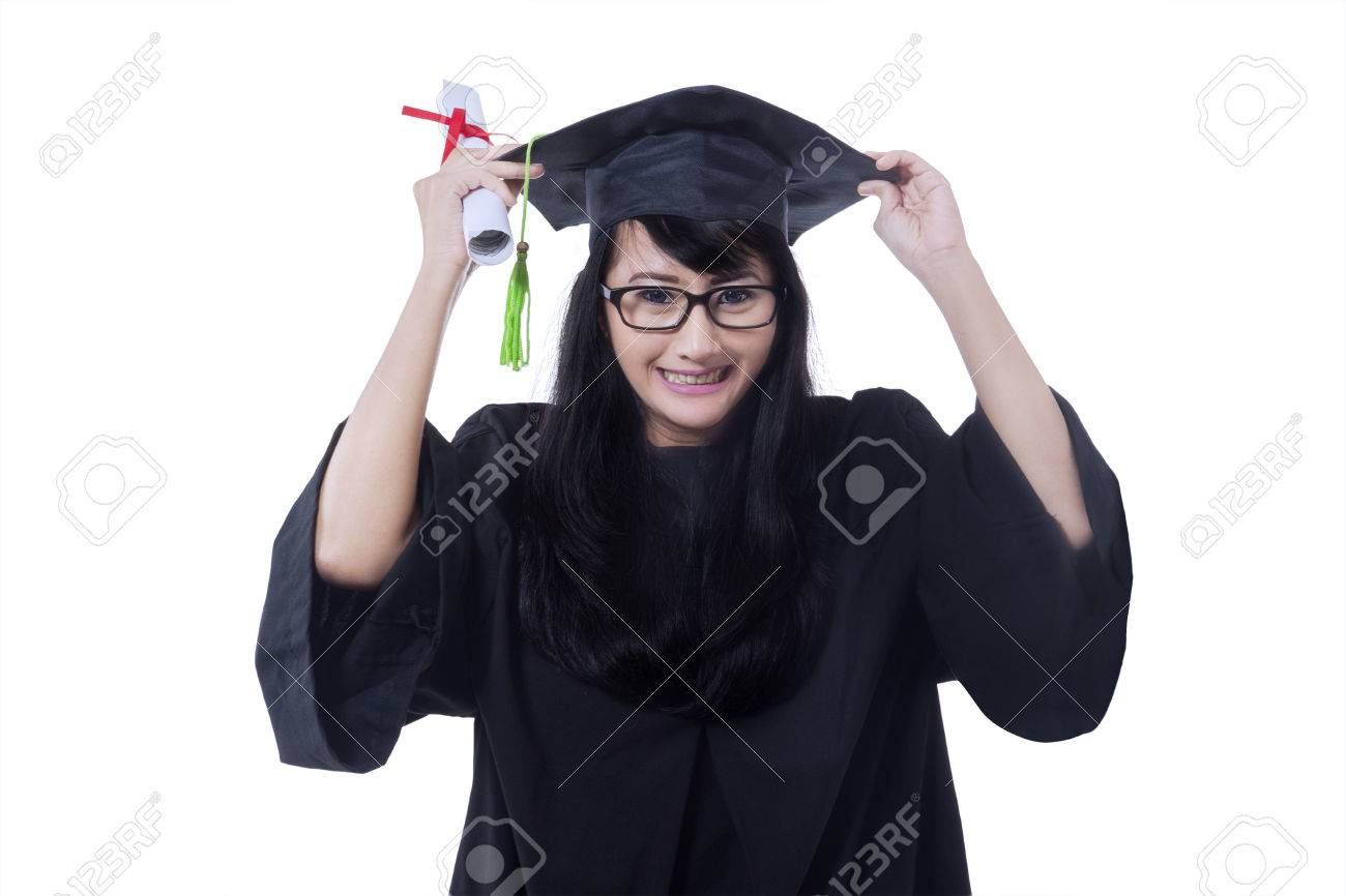 Happy Female Bachelor Wearing Graduation Gown And Celebrate Her ...