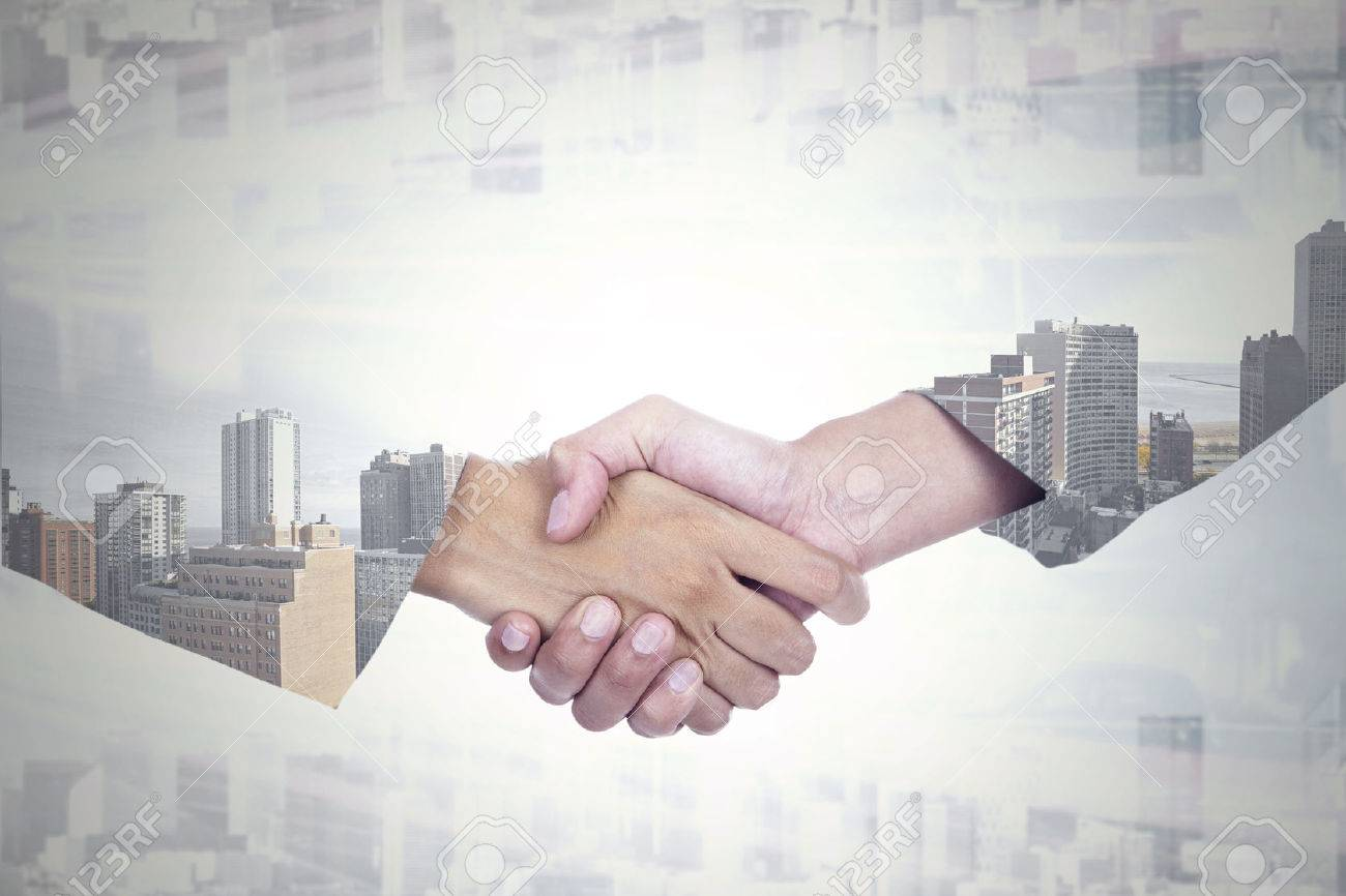 Double exposure of two businesspeople shaking hands with office building background Stock Photo - 45140173