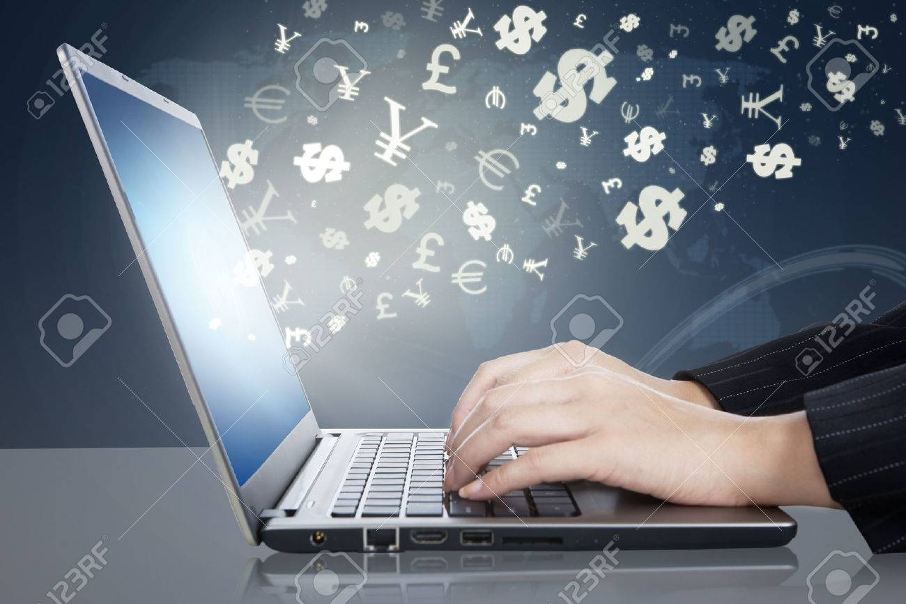 Image of businesswoman hands working on the laptop computer with currency symbols. Making money online concept Stock Photo - 45500611