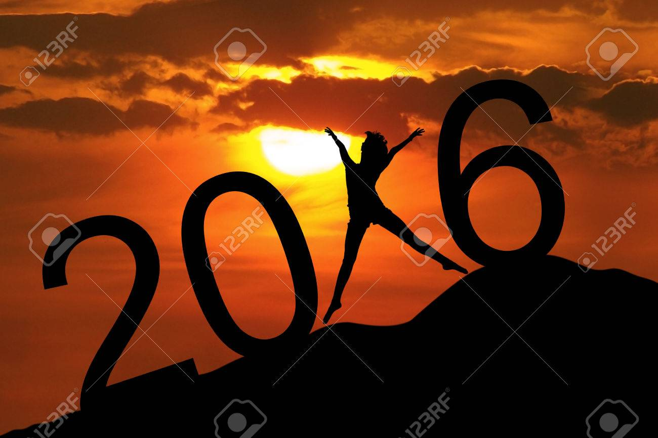 Image of silhouette happy woman jumping on the hill and forming numbers 2016 Stock Photo - 46391223