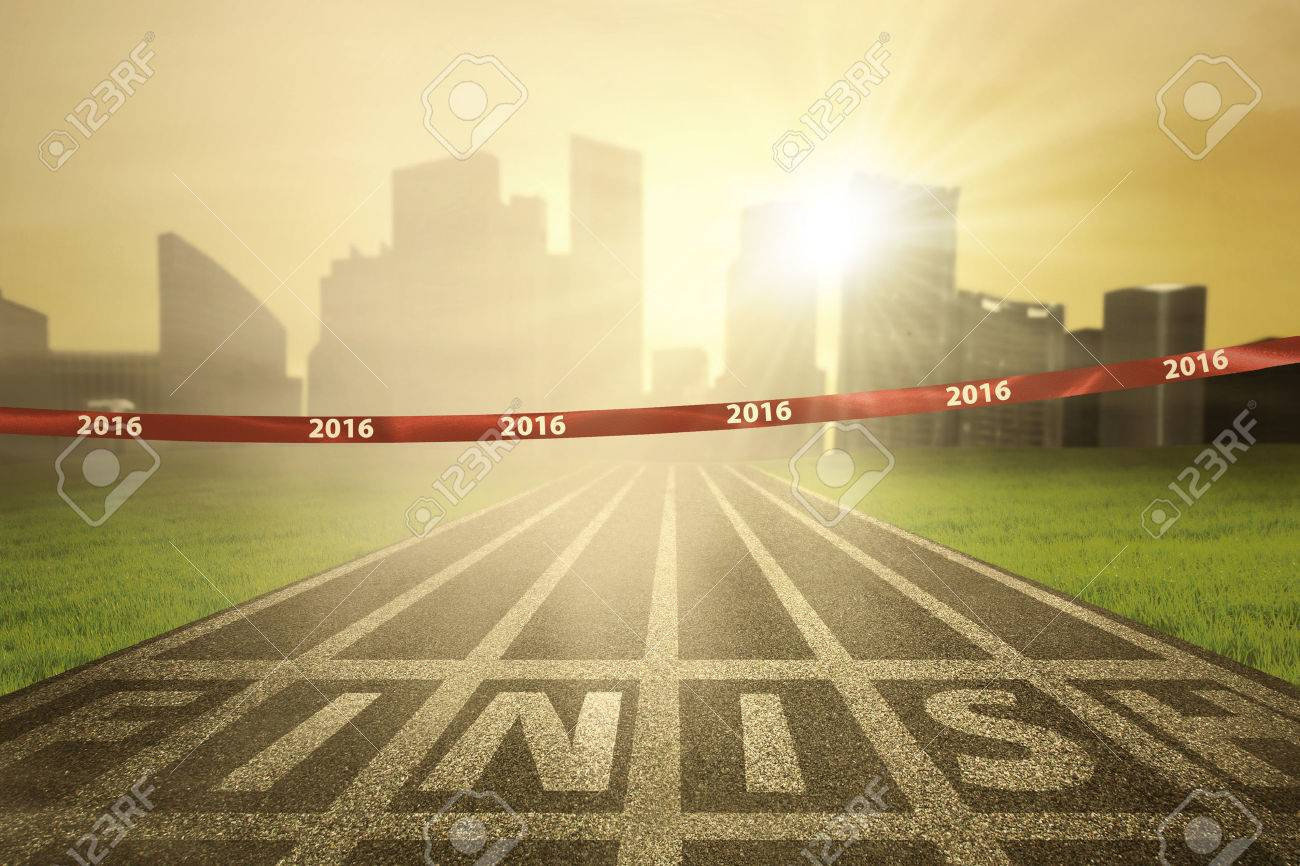 Image of an empty finish line with numbers 2016 on the tape and bright sun rays at the end of track Stock Photo - 46391111