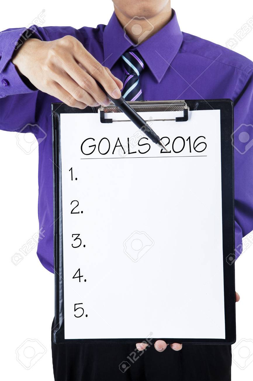 Photo of businessperson holding a clipboard and showing the lists number to make plan or goals in 2016 Banque d'images - 47289999