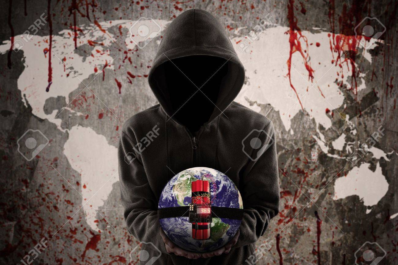 Terrorism concept: Anonymous terrorist holding a time bomb with bloody world map Stock Photo - 48554072