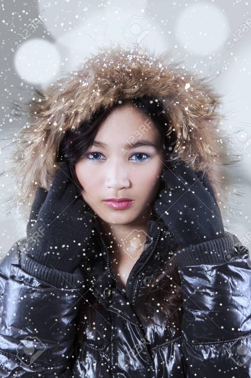 Portrait of pretty girl wearing winter jacket with beauty makeup