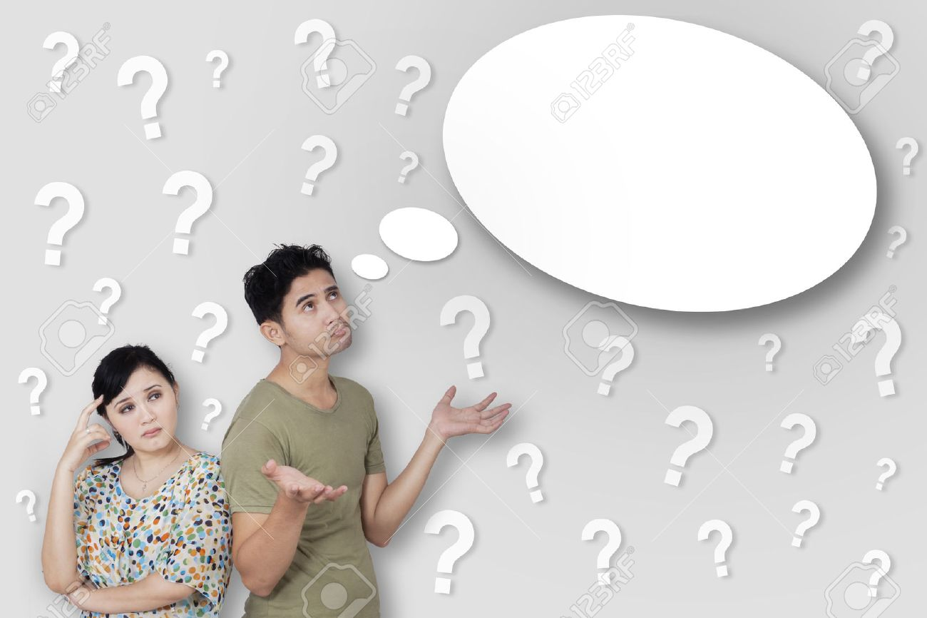 Portrait of young thoughtful couple with many question marks Stock Photo - 50252834