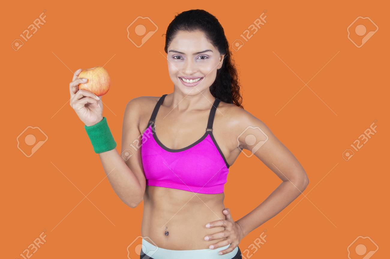 Healthy indian woman with apple for diet and weight loss concept