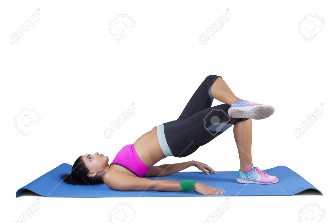 Beautiful Indian Woman Doing Yoga Pose While Wearing Sportswear Stock Photo Picture And Royalty Free Image Image 58677437